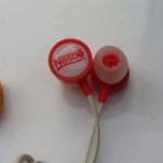 Custom Promotion Dome Epoxy Top Nestle Earphone